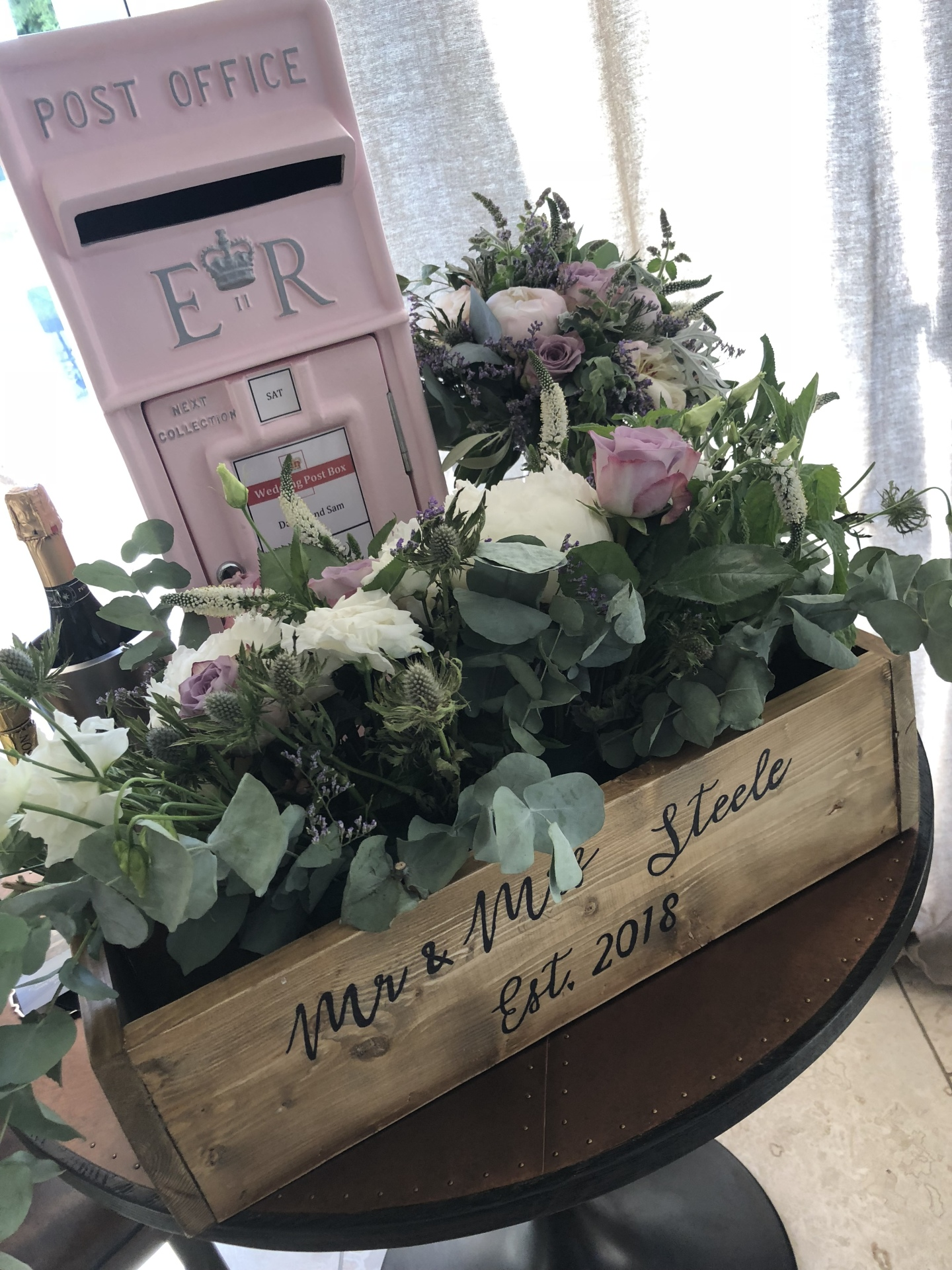 Pastel Pink Royal Mail Wedding post box surrounded by flowers