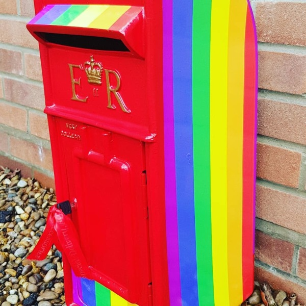 Pride rainbow themed post box, lockable and personalised.